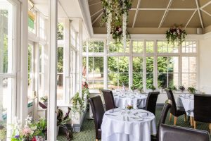The beautiful Conservatory at Woodland Manor is home to The Glass Room Restaurant, an eatery that offers country-house dining in Bedford.