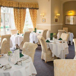 fine dining Bedfordshire with upholstered seating and laid tables